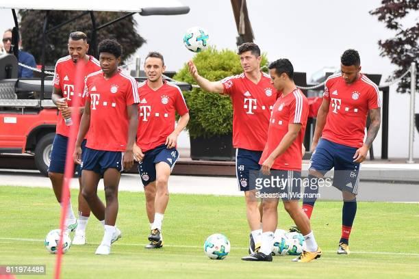 Jerome Boateng David Alaba Rafinha Robert Lewandowski Thiago Alcantara and Corentin Tolisso of FC Bayern Muenchen arrive for a training session at...