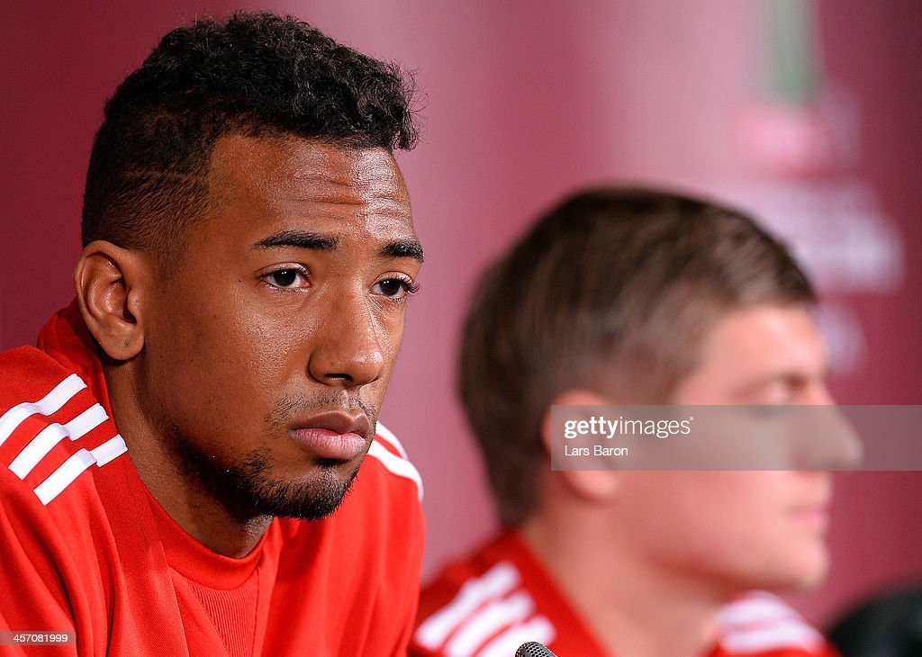 Jerome Boateng looks on next to Toni Kroos during a Bayern Muenchen press conference for the FIFA Club World Cup at Agadir Stadium on December 16, 2013 in Agadir, Morocco.