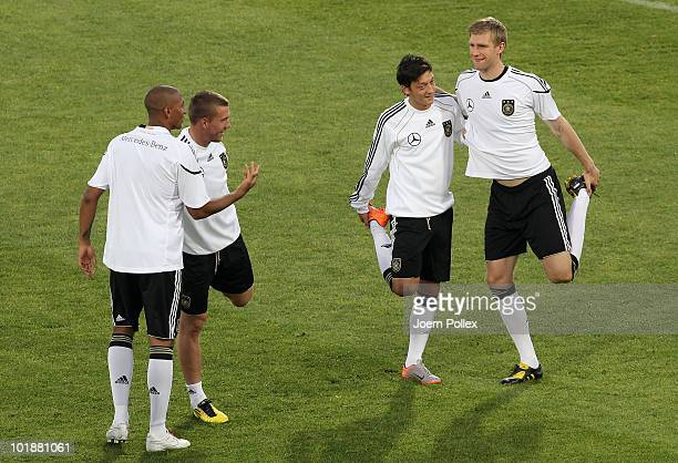 Jerome Boateng Lukas Podolski Mesut Oezil and Per Mertesacker of Germany exercise during training session at Super stadium on June 8 2010 in Pretoria...