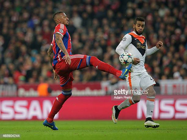 Jerome Boateng of Bayern Muenchen and Alex Teixeira of Shakhtar Donetsk battle for the ball during the UEFA Champions League Round of 16 second leg...