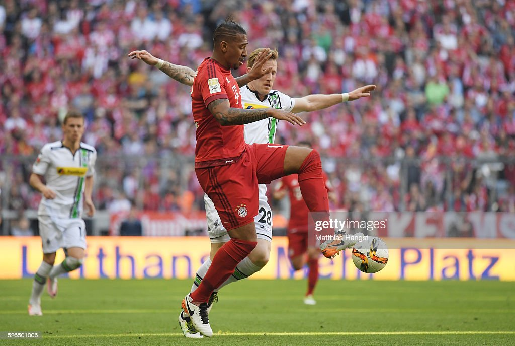 Jerome Boateng of Bayern Muenchen and Andre Hahn of Borussia Moenchengladbach compete for the ball during the Bundesliga match between Bayern Muenchen and Borussia Moenchengladbach at Allianz Arena on April 30, 2016 in Munich, Germany.
