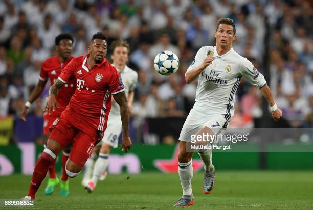 Jerome Boateng of Bayern Muenchen and Cristiano Ronaldo of Real Madrid compete for the ball during the UEFA Champions League Quarter Final second leg...