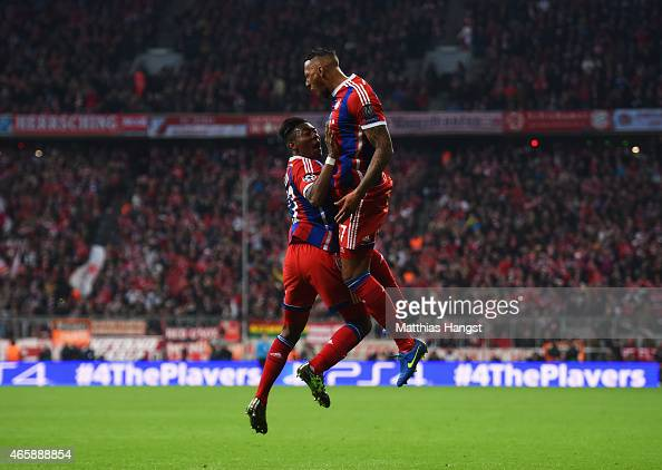 Jerome Boateng of Bayern Muenchen celebrates with David Alaba as he scores their second goal during the UEFA Champions League Round of 16 second leg...
