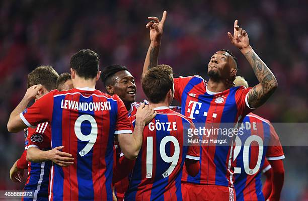 Jerome Boateng of Bayern Muenchen celebrates with team mates as he scores their second goal during the UEFA Champions League Round of 16 second leg...