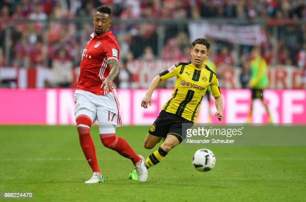 Jerome Boateng of Bayern Muenchen challenges Emre Mor of Dortmund during the Bundesliga match between Bayern Muenchen and Borussia Dortmund at...