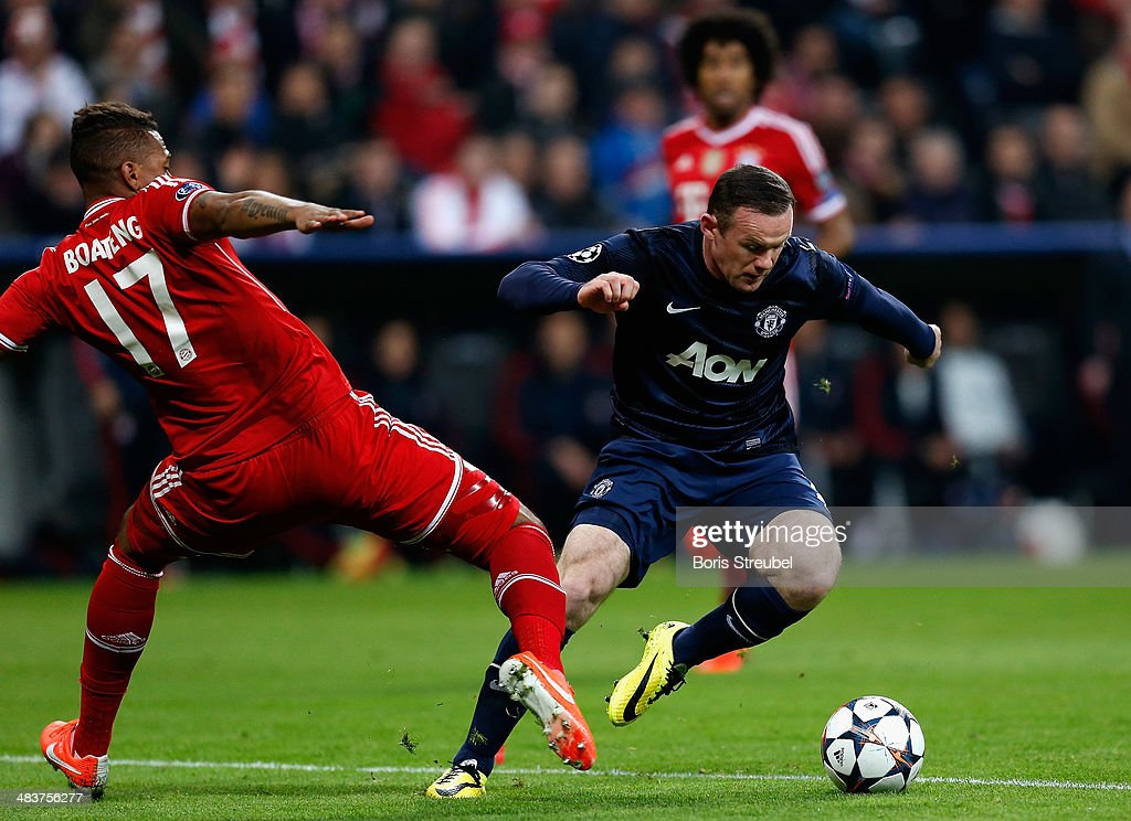Jerome Boateng (L) of Bayern Muenchen challenges Wayne Rooney of Manchester United during the UEFA Champions League Quarter Final second leg match between FC Bayern Muenchen and Manchester United at Allianz Arena on April 9, 2014 in Munich, Germany.