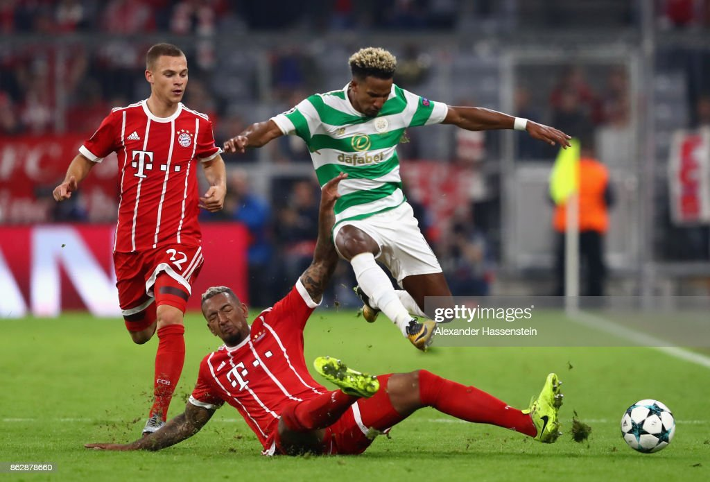 Jerome Boateng of Bayern Muenchen fouls Scott Sinclair of Celtic during the UEFA Champions League group B match between Bayern Muenchen and Celtic FC at Allianz Arena on October 18, 2017 in Munich, Germany.