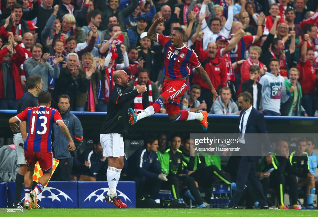 <a gi-track='captionPersonalityLinkClicked' href=/galleries/search?phrase=Jerome+Boateng&family=editorial&specificpeople=2192287 ng-click='$event.stopPropagation()'>Jerome Boateng</a> of Bayern Muenchen jumps for joy as he celebrates scoring his goal with team mates during the UEFA Champions League Group E match between Bayern Munchen and Manchester City at the Allianz Arena on September 17, 2014 in Munich, Germany.