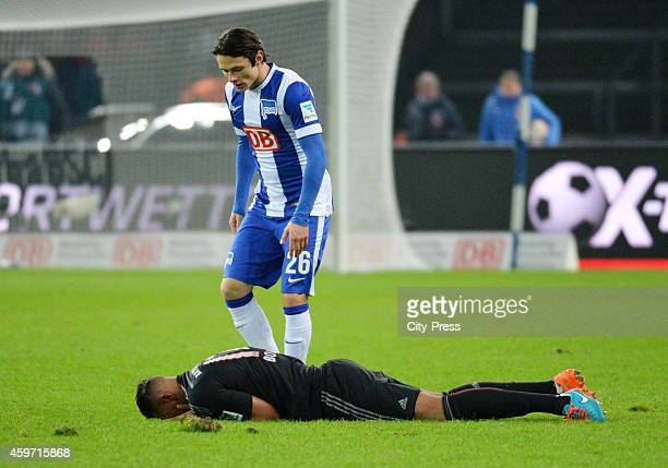 Jerome Boateng of Bayern Muenchen on Boden and Nico Schulz of Hertha BSC during the game between Hertha BSC and Bayern Muenchen on November 29 2014...