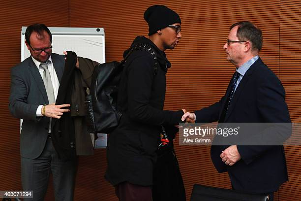 Jerome Boateng of Bayern Muenchen shakes hands with court president hans E Lorenz after a trial at the DFB Sports Court at the DFB headquarters on...