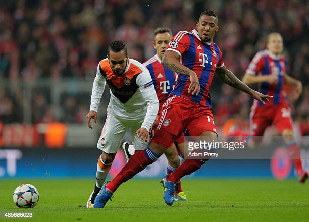Jerome Boateng of Bayern Muenchen tackled Alex Teixeira of Shakhtar Donetsk during the UEFA Champions League Round of 16 second leg match between FC...