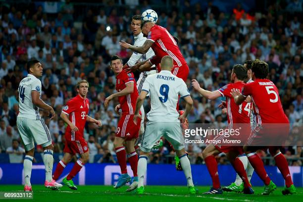 Jerome Boateng of Bayern Muenchen wins the header after Cristiano Ronaldo of Real Madrid CF during the UEFA Champions League Quarter Final second leg...