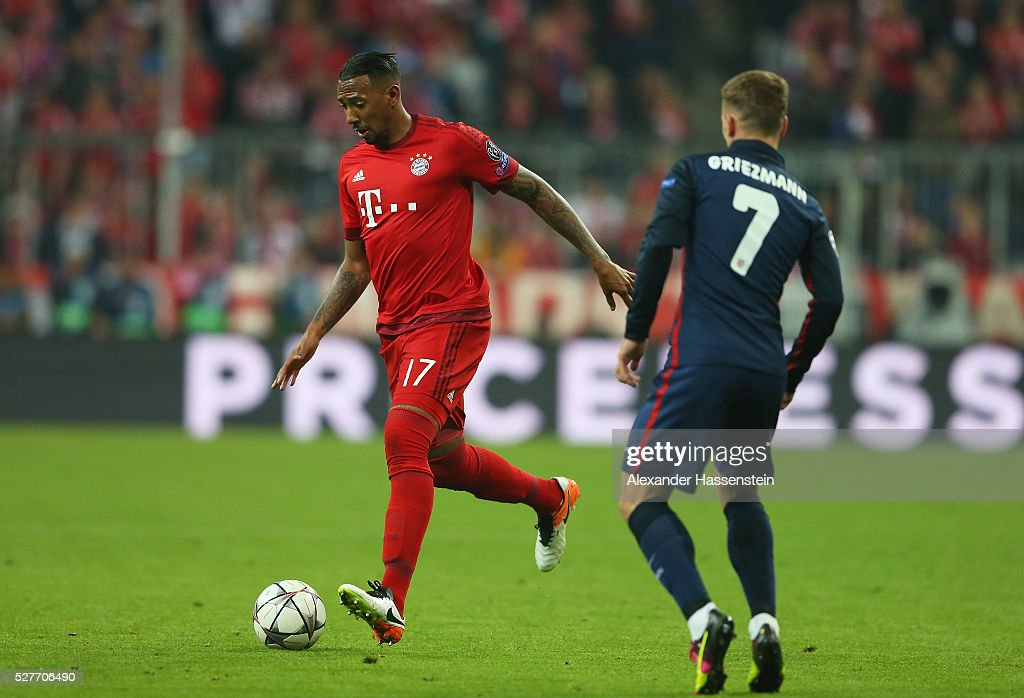 Jerome Boateng of Bayern Munich is watched by Antoine Griezmann of Atletico Madrid during UEFA Champions League semi final second leg match between FC Bayern Muenchen and Club Atletico de Madrid at Allianz Arena on May 3, 2016 in Munich, Germany.