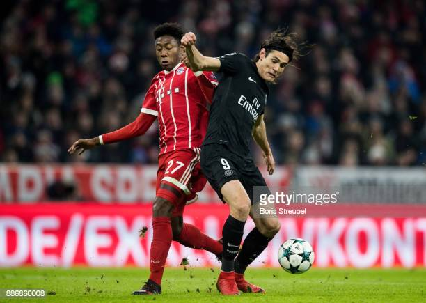 Jerome Boateng of FC Bayern Muenchen battles for the ball with Edinson Cavani of Paris SaintGermain during the UEFA Champions League group B match...