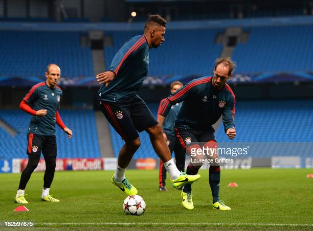 Jerome Boateng of FC Bayern Muenchen in action during a training session at Etihad Stadium on October 1 2013 in Manchester England