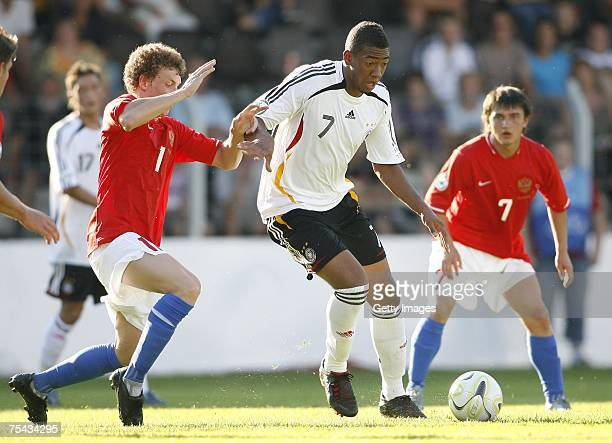 Jerome Boateng of Germany and Pavel Mamaev of Russia fight for the ball during the UEFA U19 European Championship between Germany and Russia at the...