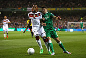 Jerome Boateng of Germany and Robbie Brady of Republic of Ireland battle for the ball during the UEFA EURO 2016 Qualifier group D match between...