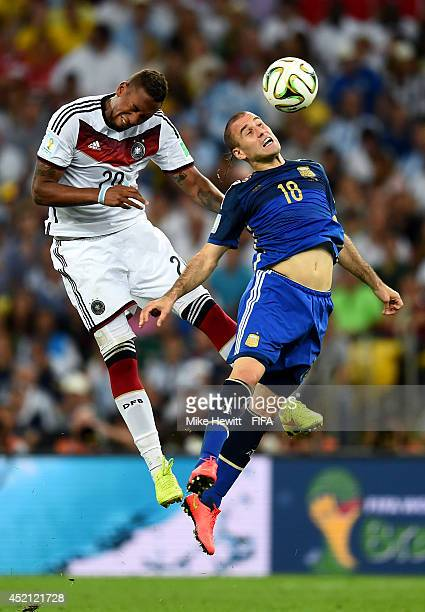 Jerome Boateng of Germany and Rodrigo Palacio of Argentina compete for the ball during the 2014 FIFA World Cup Brazil Final match between Germany and...