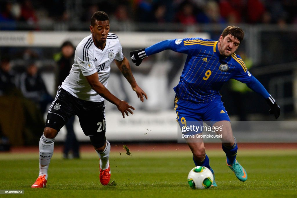 Jerome Boateng of Germany and Sergey Ostapenko of Kazakhstan battle for the ball during the FIFA 2014 World Cup Qualifier match between Germany and Kazakhstan at Grundig-Stadion on March 26, 2013 in Nuremberg, Germany.