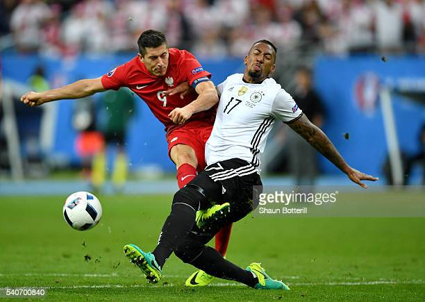 Jerome Boateng of Germany blocks the shot by Robert Lewandowski of Poland during the UEFA EURO 2016 Group C match between Germany and Poland at Stade...