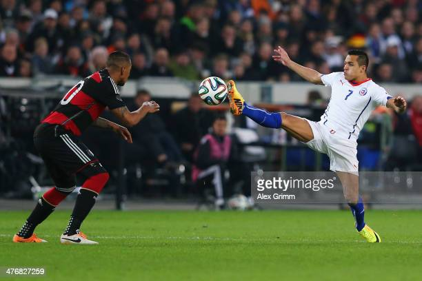Jerome Boateng of Germany is challenged by Alexis Sanchez of Chile during the international friendly match between Germany and Chile at MercedesBenz...