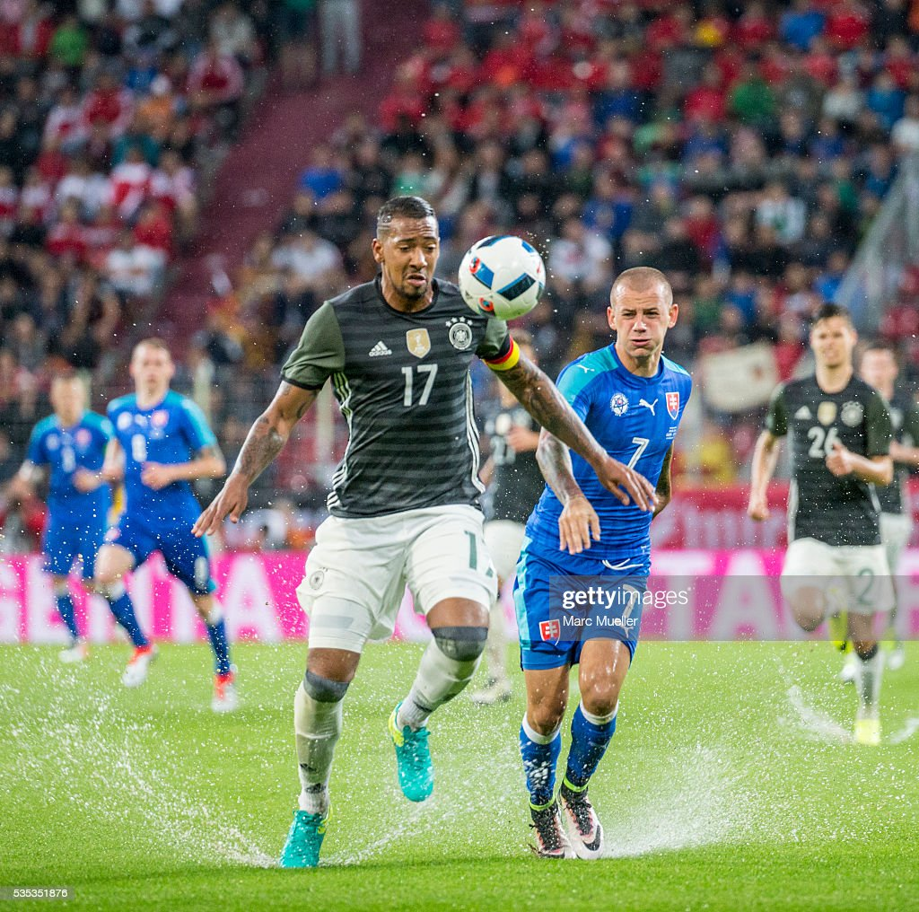 Jerome Boateng (L) of Germany is challenged by Vladimir Weiss of Slovakia during during the international friendly match between Germany and Slovakia at WWK-Arena on May 29, 2016 in Augsburg, Germany.