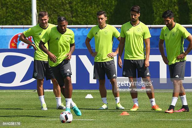 Jerome Boateng of Germany plays the ball during a Germany training session ahead of their Euro 2016 quarter final match against Italy at Ermitage...