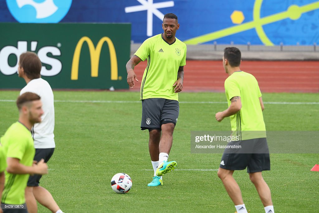 <a gi-track='captionPersonalityLinkClicked' href=/galleries/search?phrase=Jerome+Boateng&family=editorial&specificpeople=2192287 ng-click='$event.stopPropagation()'>Jerome Boateng</a> of Germany plays with the ball during a Germany training session ahead of their Euro 2016 round of 16 match against Slovakia at Ermitage Evian on June 25, 2016 in Evian-les-Bains, France.