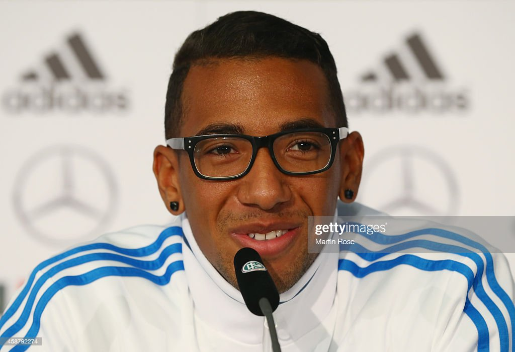 <a gi-track='captionPersonalityLinkClicked' href=/galleries/search?phrase=Jerome+Boateng&family=editorial&specificpeople=2192287 ng-click='$event.stopPropagation()'>Jerome Boateng</a> of Germany reacts during a press conference ahead of their EURO 2016 Group D qualifying match against Gibraltar on November 11, 2014 in Berlin, Germany.