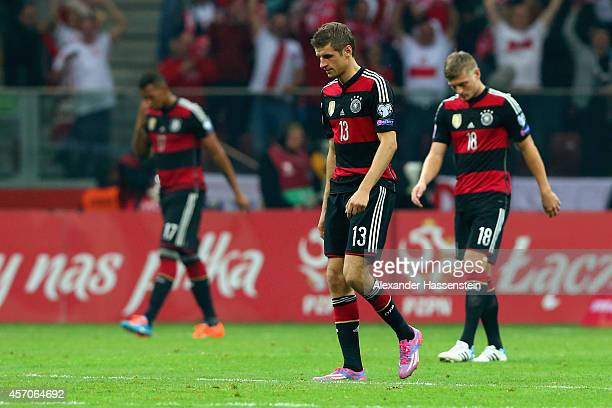 Jerome Boateng of Germany recats with his team mates Thomas Mueller and Toni Kroos after receiving the first goal during of the EURO 2016 Group D...