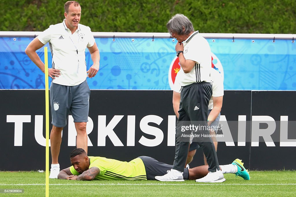 <a gi-track='captionPersonalityLinkClicked' href=/galleries/search?phrase=Jerome+Boateng&family=editorial&specificpeople=2192287 ng-click='$event.stopPropagation()'>Jerome Boateng</a> of Germany receives medical treatment from team doctor Hans-Wilhelm Mueller-Wohlfahrt during a Germany training session ahead of their Euro 2016 round of 16 match against Slovakia at Ermitage Evian on June 25, 2016 in Evian-les-Bains, France.