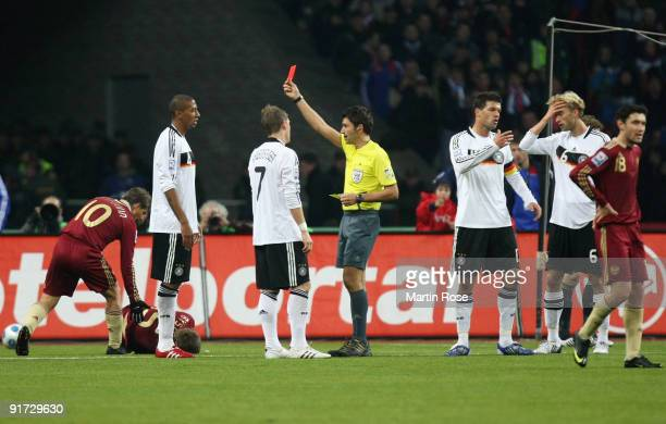 Jerome Boateng of Germany receives the yellow red card by swiss referee Massimo Busacca during the FIFA 2010 World Cup Group 4 Qualifier match...