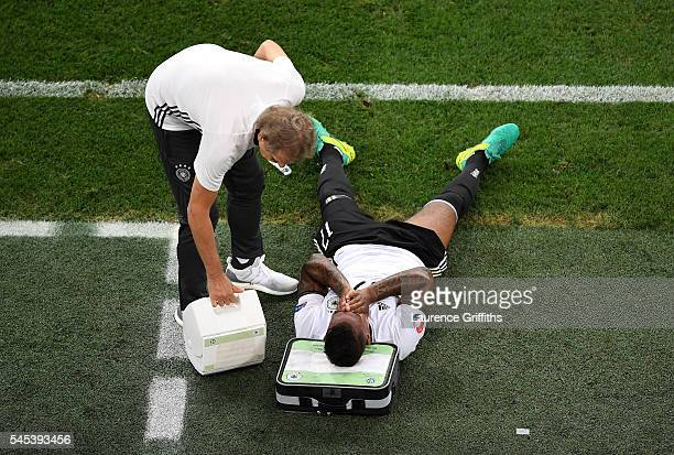 Jerome Boateng of Germany receives treatment on the touchline during the UEFA EURO semi final match between Germany and France at Stade Velodrome on...
