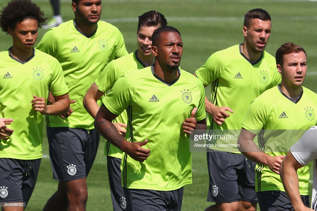 <a gi-track='captionPersonalityLinkClicked' href=/galleries/search?phrase=Jerome+Boateng&family=editorial&specificpeople=2192287 ng-click='$event.stopPropagation()'>Jerome Boateng</a> of Germany runs with his team mates during a Germany training session ahead of their Euro 2016 quarter final match against Italy at Ermitage Evian on July 01, 2016 in Evian-les-Bains, France.