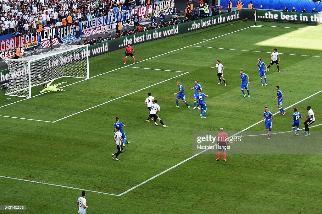 <a gi-track='captionPersonalityLinkClicked' href=/galleries/search?phrase=Jerome+Boateng&family=editorial&specificpeople=2192287 ng-click='$event.stopPropagation()'>Jerome Boateng</a> (1st R) of Germany scores the opening goal during the UEFA EURO 2016 round of 16 match between Germany and Slovakia at Stade Pierre-Mauroy on June 26, 2016 in Lille, France.