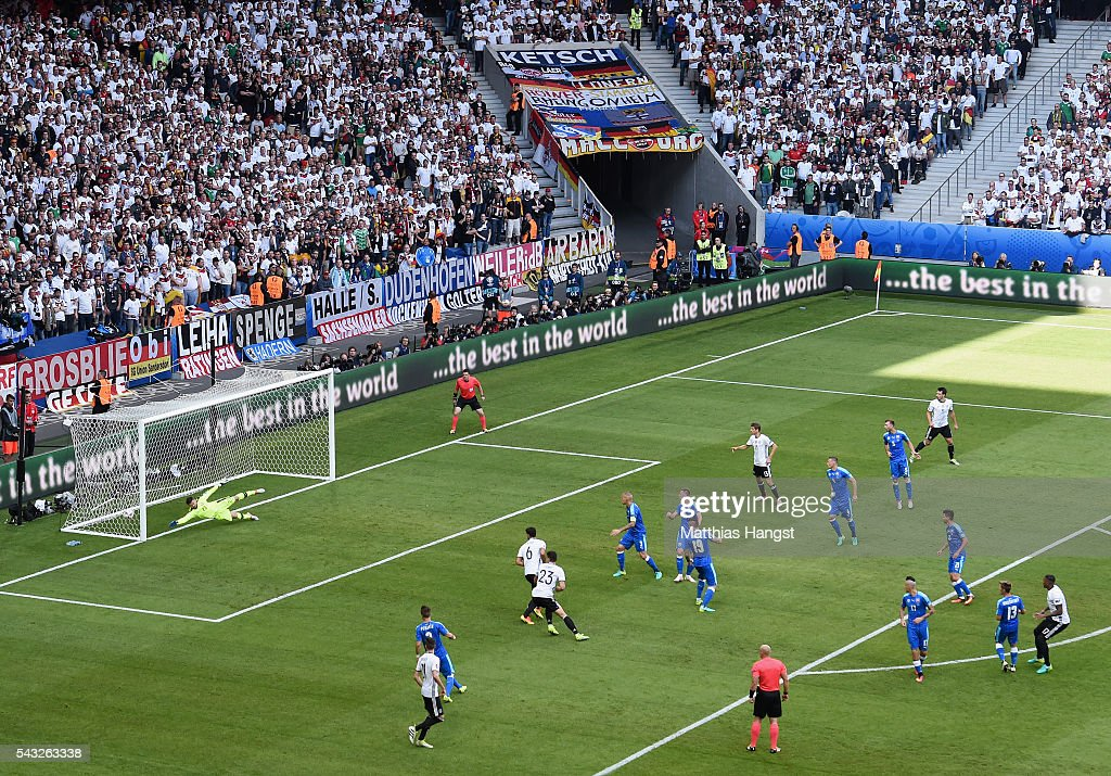 Jerome Boateng (1st R) of Germany scores the opening goal during the UEFA EURO 2016 round of 16 match between Germany and Slovakia at Stade Pierre-Mauroy on June 26, 2016 in Lille, France.
