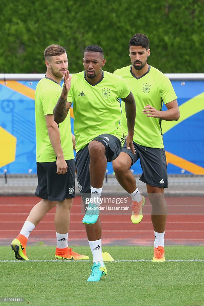 <a gi-track='captionPersonalityLinkClicked' href=/galleries/search?phrase=Jerome+Boateng&family=editorial&specificpeople=2192287 ng-click='$event.stopPropagation()'>Jerome Boateng</a> of Germany warms up for a Germany training session ahead of their Euro 2016 round of 16 match against Slovakia at Ermitage Evian on June 25, 2016 in Evian-les-Bains, France.