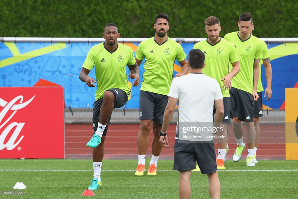 <a gi-track='captionPersonalityLinkClicked' href=/galleries/search?phrase=Jerome+Boateng&family=editorial&specificpeople=2192287 ng-click='$event.stopPropagation()'>Jerome Boateng</a> (L) of Germany warms up for a Germany training session ahead of their Euro 2016 round of 16 match against Slovakia at Ermitage Evian on June 25, 2016 in Evian-les-Bains, France.