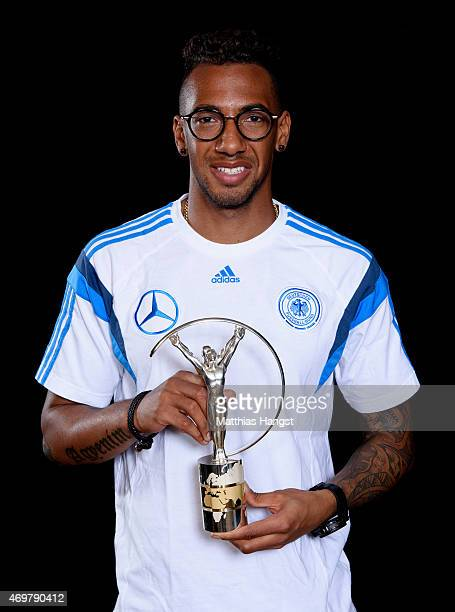 Jerome Boateng of Germany winners of the Laureus World Team of the Year 2015 poses with the award at the Villa Kennedy hotel on March 23 2015 in...