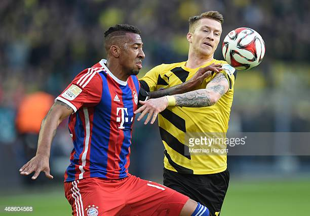 Jerome Boateng of Muenchen and Marco Reus of Dortmund compete for the ball during the Bundesliga match between Borussia Dortmund and FC Bayern...