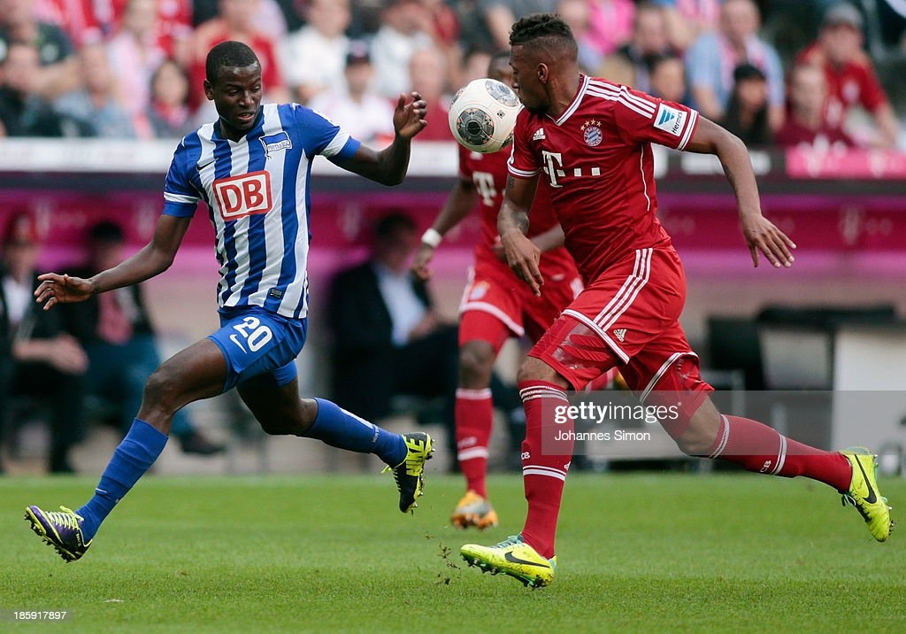 Jerome Boateng (R) of Muenchen battles for the ball with Ramos Vasquez (L) of Berlin during the Bundesliga match between FC Bayern Muenchen and Hertha BSC Berlin at Allianz Arena at Allianz Arena on October 26, 2013 in Munich, Germany.