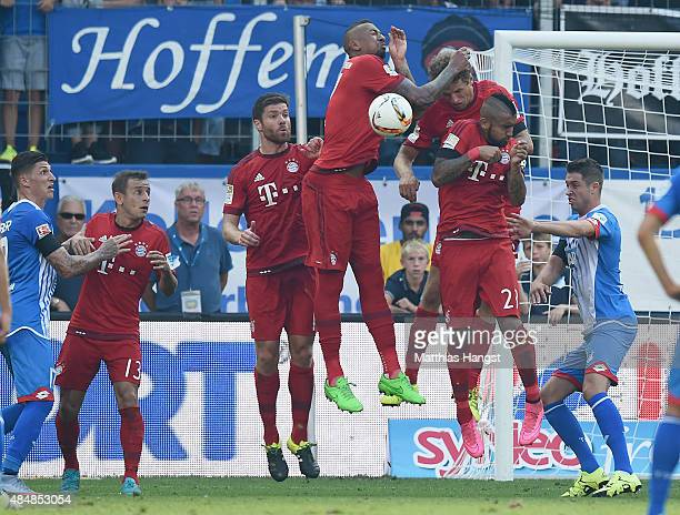 Jerome Boateng of Muenchen blocks a free kick with his hand during the Bundesliga match between 1899 Hoffenheim and FC Bayern Muenchen at Wirsol...