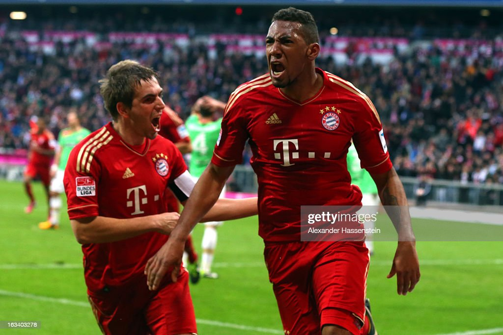 Jerome Boateng (R) of Muenchen celebrates scoring the winning goal with his team mate Philipp Lahm during the Bundesliga match between FC Bayern Muenchen and Fortuna Duesseldorf 1895 at Allianz Arena on March 9, 2013 in Munich, Germany.