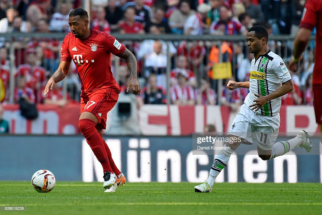 Jerome Boateng of Muenchen (L) is challenged by Raffael of Moenchengladbach during the Bundesliga match between FC Bayern Muenchen and Borussia Moenchengladbach at Allianz Arena on April 30, 2016 in Munich, Germany.