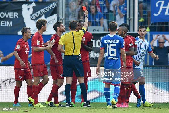 Jerome Boateng of Muenchen is shown a yellowred card by referee Tobias Stieler during the Bundesliga match between 1899 Hoffenheim and FC Bayern...
