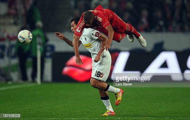 Jerome Boateng of Muenchen jumps over Juan Arango of Moenchengladbach during the Bundesliga match between Borussia Moenchengladbach and Bayern...