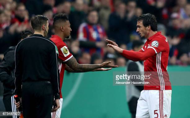 Jerome Boateng of Muenchen replaces mats Hummels during the DFB Cup semi final match between FC Bayern Muenchen and Borussia Dortmund at Allianz...