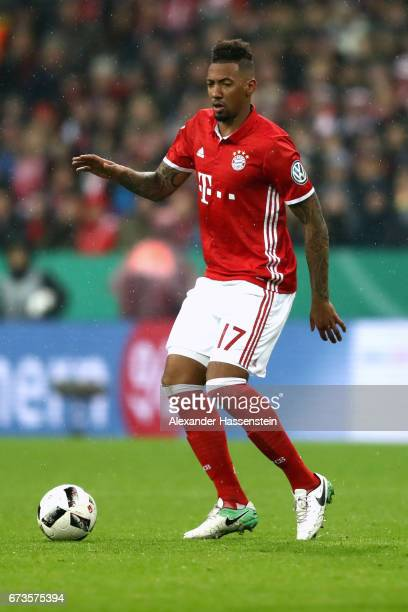 Jerome Boateng of Muenchen runs with the ball during the DFB Cup semi final match between FC Bayern Muenchen and Borussia Dortmund at Allianz Arena...