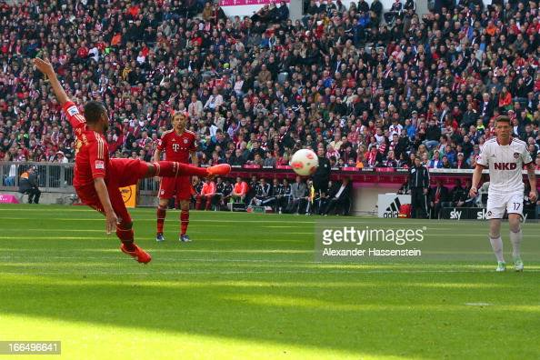 Jerome Boateng of Muenchen scores the opening goal during the Bundesliga match between FC Bayern Muenchen and 1 FC Nuernberg at Allianz Arena on...
