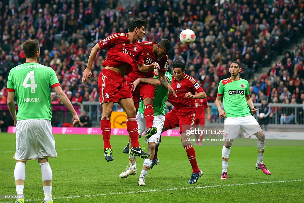Jerome Boateng (C) of Muenchen scores the winning goal during the Bundesliga match between FC Bayern Muenchen and Fortuna Duesseldorf 1895 at Allianz Arena on March 9, 2013 in Munich, Germany.